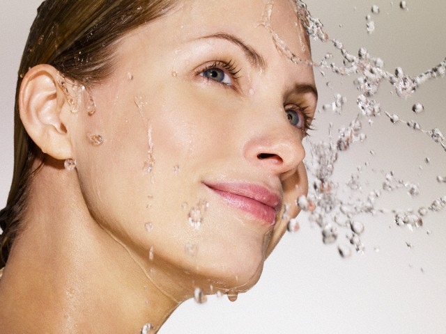 Water on face of woman