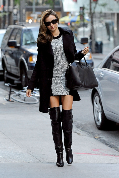 Miranda Kerr wears a short dress with thigh high boots and a warm coat as she is spotted out and about in NYC